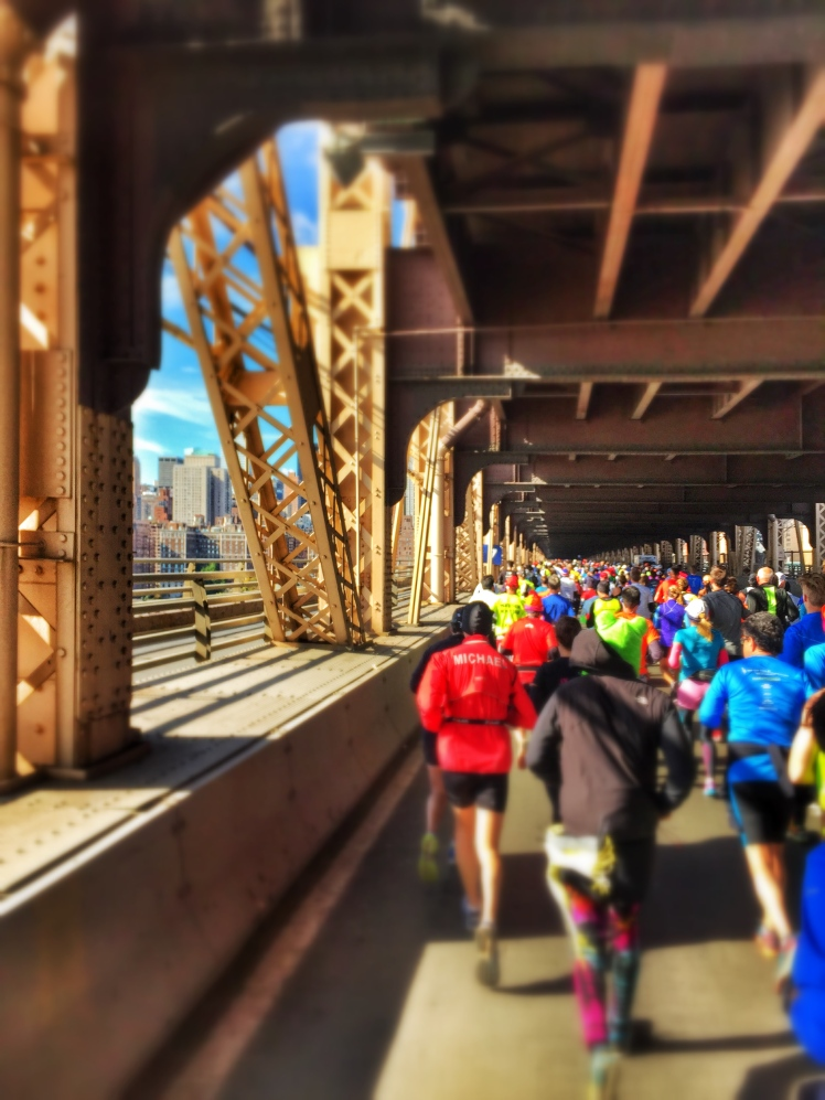 Heading over the Queensboro Bridge about to hit Manhattan to a roar of spectators