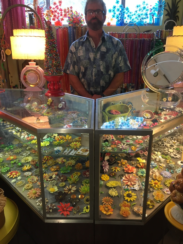 Yes, a guy in a flannel shirt hawking flower broaches. This is how they do in Palm Springs.